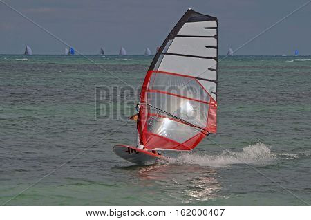 Windsurfer off of Virginia Key a popular sailboarding venue on Key Biscayne,Florida