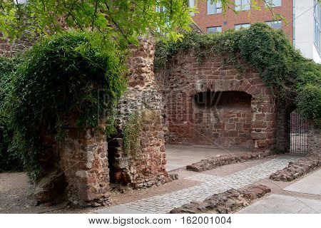 Remains of Roman wall in the city center of Exeter. Devon. England