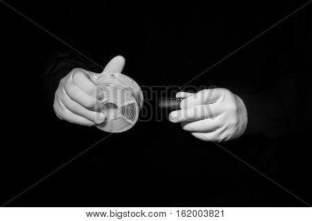 laboratory, hands in white gloves hold a black and white film, darkroom, film development