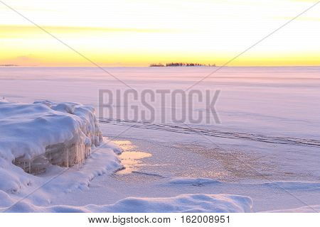 Snow landscape with the beautiful winter sunrise