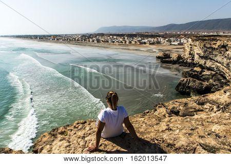 girl coastside view Taqah plateau City Salalah Dhofar Sultanate of Oman 3