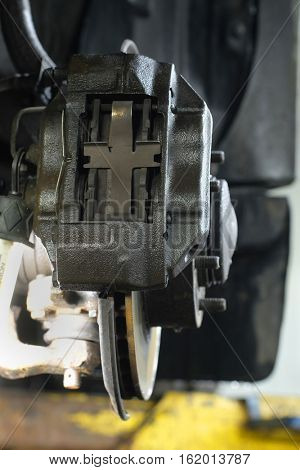 caliper of the car which is hung out on the lift