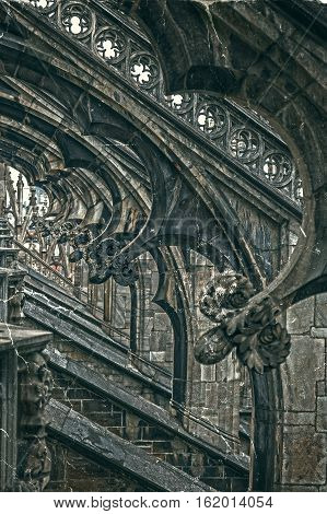Old photo with architectonic details from roof of the famous Milan Cathedral Lombardy Italy. Vintage processing.