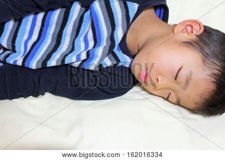 Sleeping Japanese boy (first grade at elementary school)