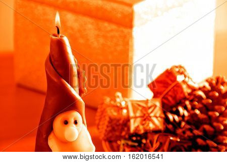 Santa Clause candle with gift boxes at Christmas time