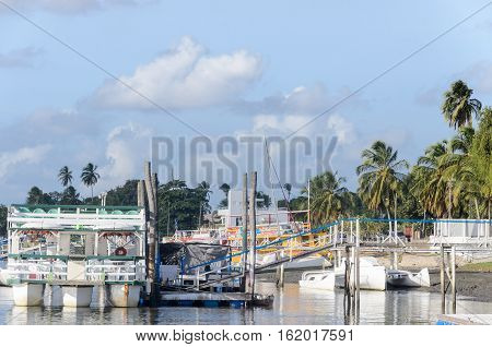 Joao Pessoa PB Brazil - December 8 2016: Picture of Praia do Jacare beach several boats side by side in the boat harbor.