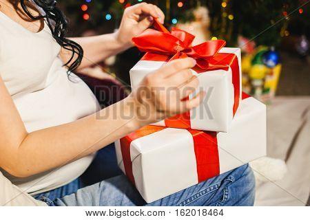 Pregnant Woman Unpacking Christmas Box