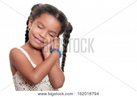 African american small girl with a cute innocent look isolated on a white background