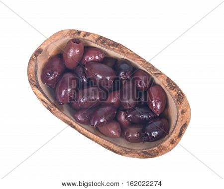Jumbo pitted kalamata olives in olive wood bowl isolated on white background
