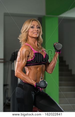 Woman Doing Heavy Weight Exercise For Biceps