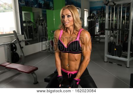 Fitness Woman Doing Exercise For Butt With Dumbbells