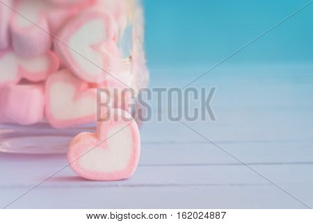 Pink heart shape marshmallow for love theme and Valentine background concept. Pile of love and sweet heart. Romance of love by pink heart pastel color. Love inspiration from sweet food heart shape. Sweet heart in love holiday background. poster