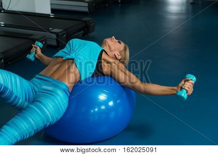 Fitness Woman Doing Exercise On Ball