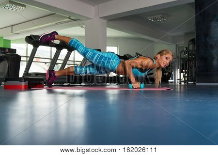Mature Woman Doing Push Ups On Floor