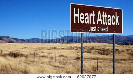 Heart Attack road sign with blue sky and wilderness