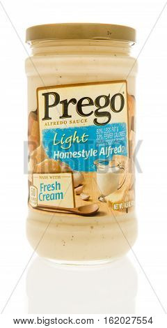 Winneconne WI - 13 December 2016: Jar of Prego light homestyle alfredo sauce on an isolated background.