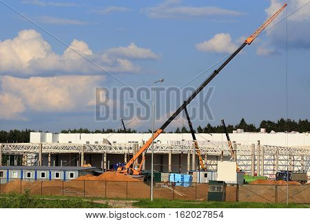 Cranes on the construction site of the large industrial facility
