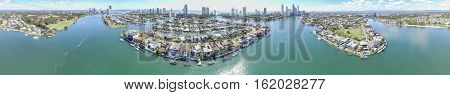 360 degree aerial panorama of Gold Coast waterways spanning Macintosh, Cronin and Chevron islands with Surfers Paradise Gold Coast in the horizon