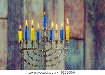 Jewish Holiday Hanukkah Background With Menorah Traditional Candelabra And Burning Candles