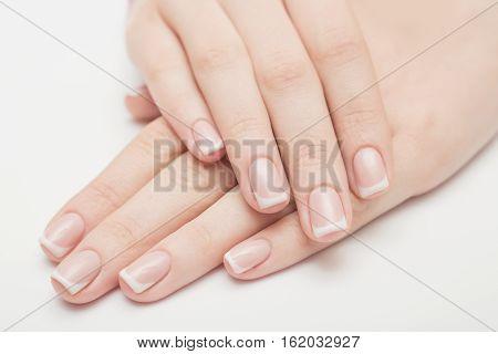 Nails saloon woman applying nail polish gel
