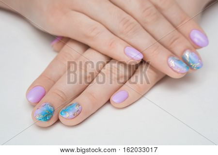 Master with beautiful blue shellac manicure women
