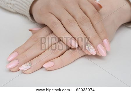 Manicure Beauty treatment photo of nice manicured woman fingernails. Very nice feminine nail art with nice pink, gold and black nail polish.