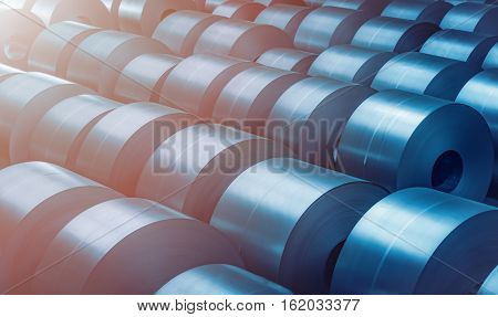 Cold rolled steel coil at storage area in steel industry plant. Vintage blue tone