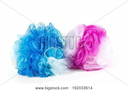 Blue And Pink Loofahs Isolated On White Background