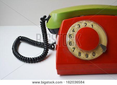 handset of vintage telephone on white background