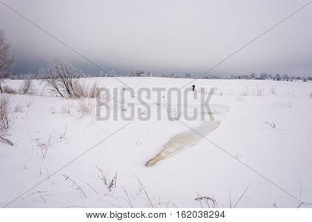 Winter Landscape With A Skier.