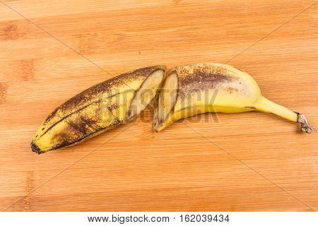 Old Beaten Cut Up Banana Isolated On White Background