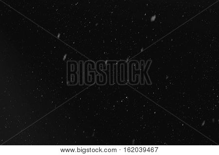 Rain or snow fall concept. Falling raindrops on black background. Just change blending mode to