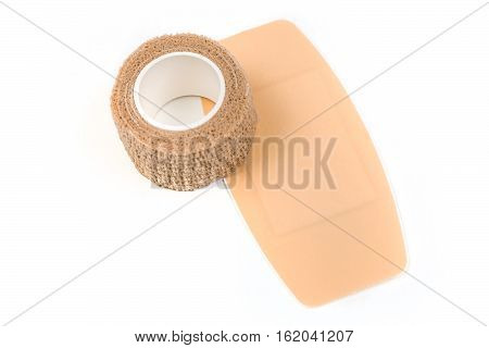 Large sticky bandage and bandage wrap isolated on white background