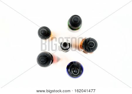 Assorted Flavors Of Vape Juice And An Ecigarette Overhead View Isolated On White Background