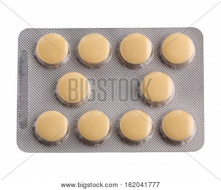 Blister yellow tablets isolated on a white background. The view from the top.