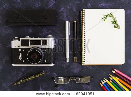 Flat Lay, Top View Office Table Desk. Desk Workspace With Retro Camera, Diary, Pen, Glasses, Case, R