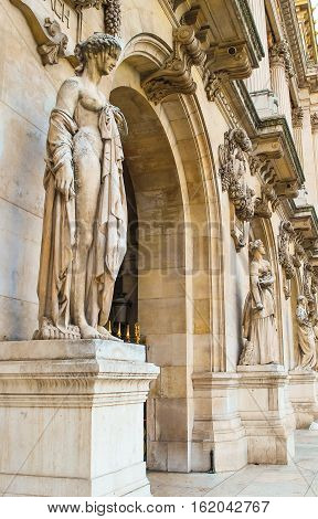 Facade of the Grand Opera (Opera Garnier) in Paris is decorated with sculptures in the style of Greek mythology. France, Paris. June 30, 2012