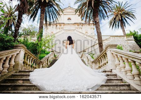 Bride In Wedding Dress With Church Background