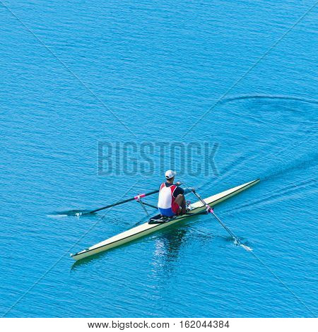 Single scull sport rowing, toned image,  square