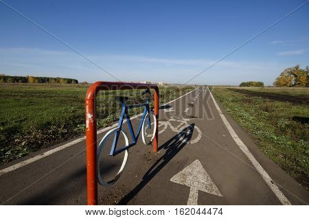 bicycle track in the summer on the nature between the field and forest