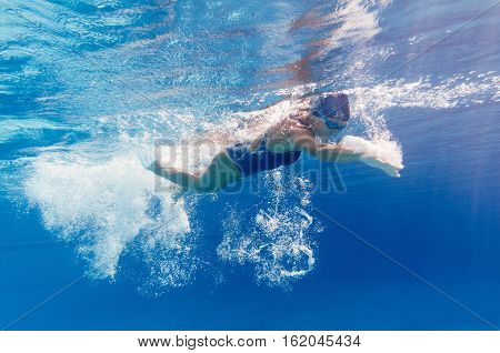 Underwater image of swimmer in motion, toned image, horizontal image