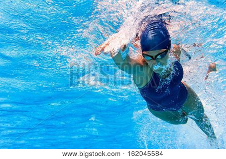 Underwater image of swimmer in action, toned image, horizontal image
