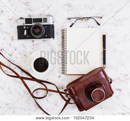 Flat Lay, Top View Office Table Desk. Desk Workspace With Retro Camera, Diary, Pen, Glasses, Case, C