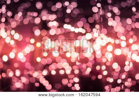 Bokeh background  lights in pink, purple, red and orange. Bblurred light in black  tone background. Store shop mall concept. soft focus dream city blurry rich golden bubble light wallpaper