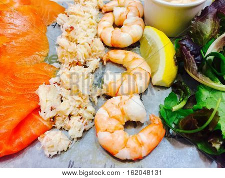 Mixed seafood platter served on a slate