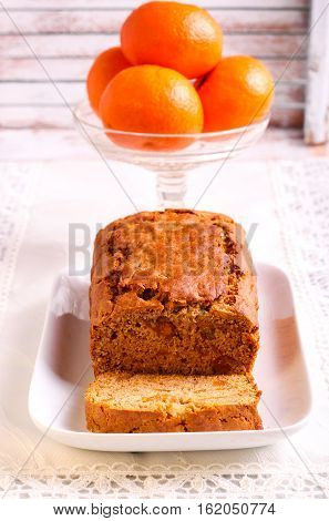 Clementine rye flour honey and spice cake sliced and served