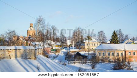 Winter rural landscape with the ruins of the church