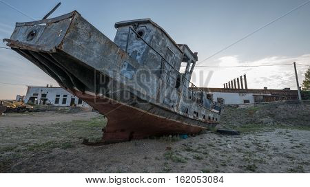 forgotten and broken historical artifact of a fishing vessel