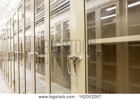 an room with empty metal boxes with see-through glass