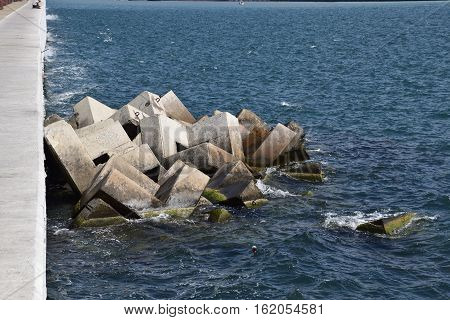 Breakwater Of The Rectangular Stone Figures.